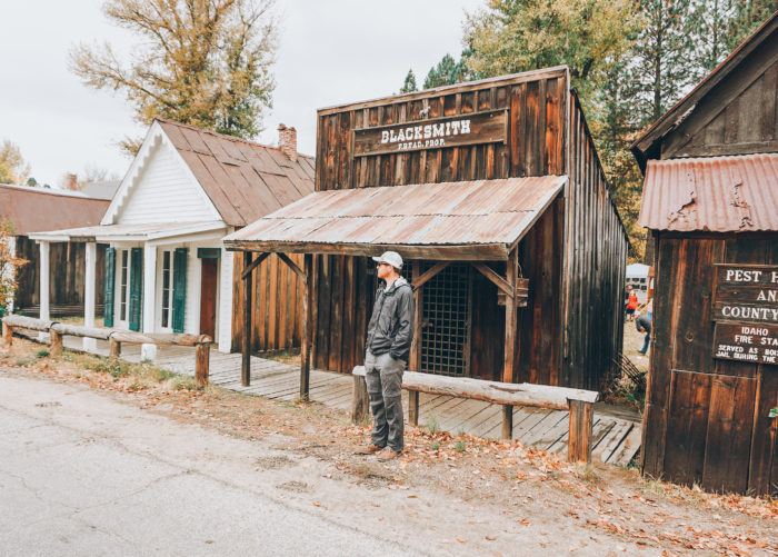 standing outside historic building in Idaho City