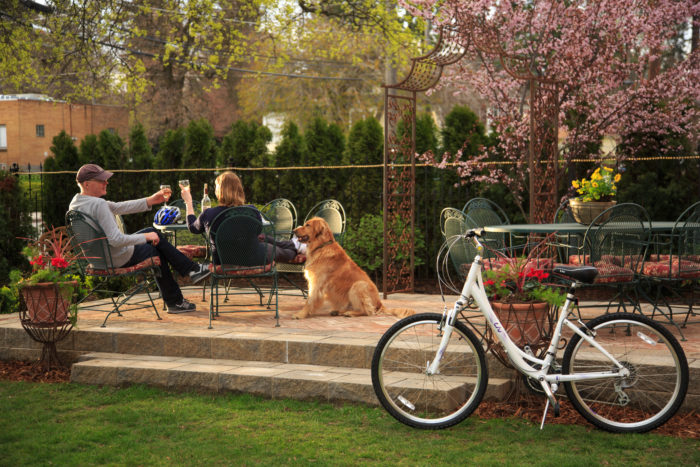 man and woman on patio with dog