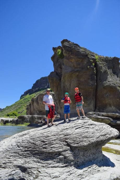 family standing on rock - pillar falls