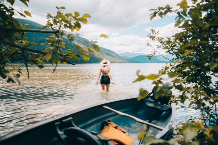 woman standing in lake water