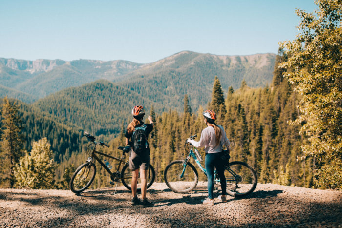 people with bikes looking at forest