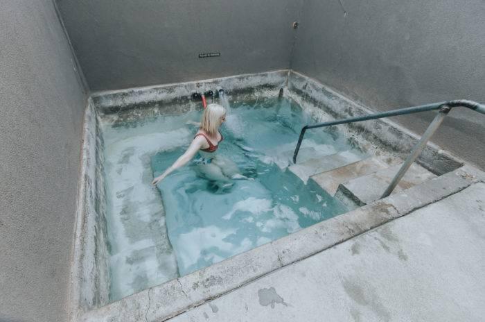 woman soaking at miracle hot springs
