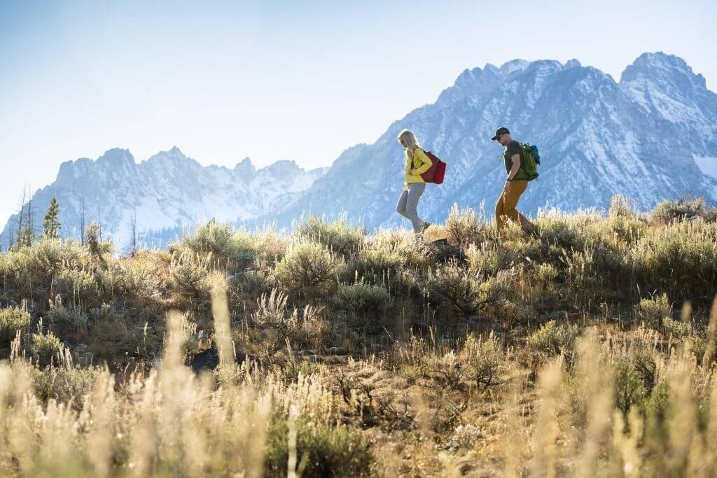 two people hike on marshall ridge near stanley