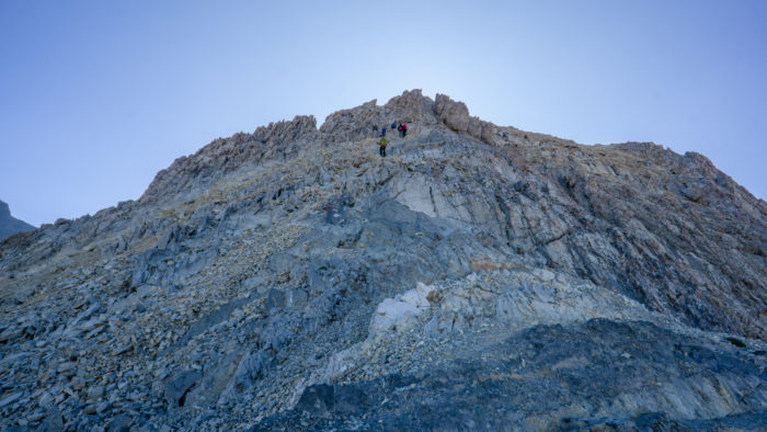 man climbing mount borah