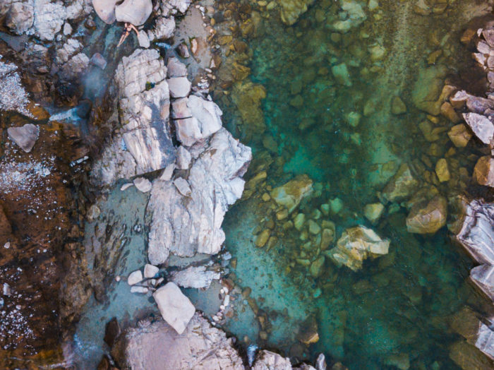 Stop by Kirkham Hot Springs for a riverside soak. Photo Credit: Rolling Van Creative.