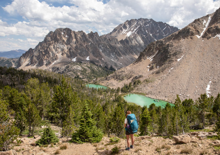 woman hiking high mountain lake