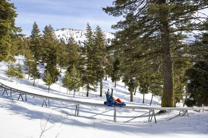 couple on mountain coaster at bogus basin