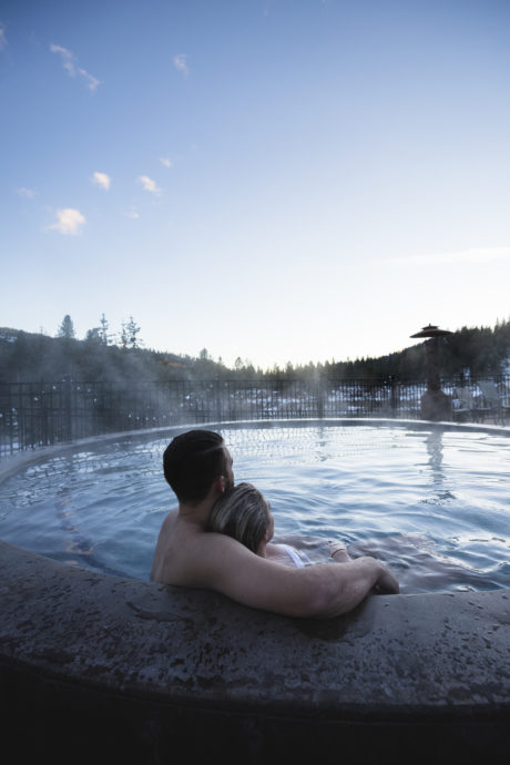 couple sitting in hot tub at The Springs