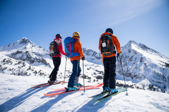 skiers at the top of a mountian