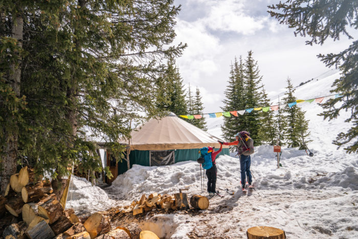 skiers standing by yurt