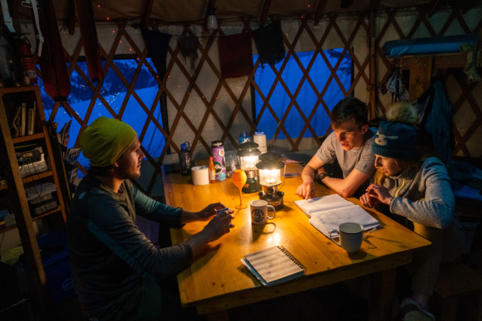 people sitting at table in a yurt