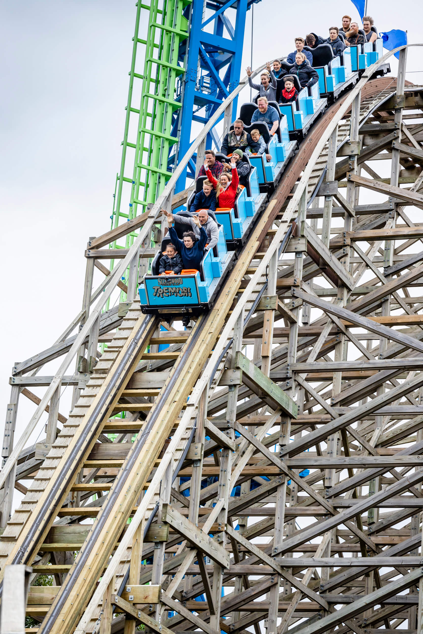 group of twenty people on a wooden roller coaster at Silverwood Theme Park