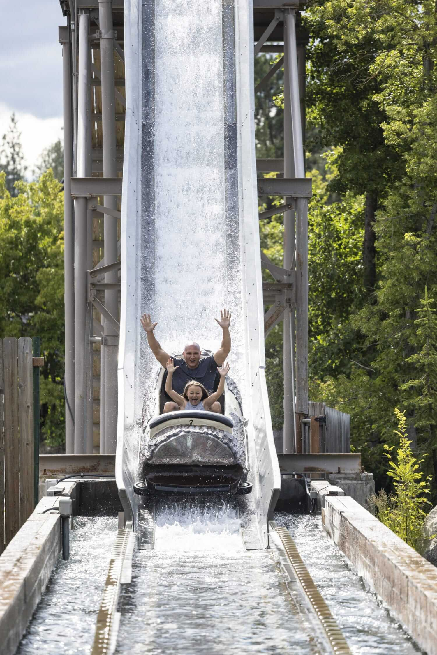 dad and daughter on splash ride at silverwood