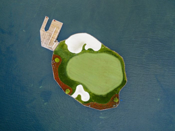 Enjoy a one-of-a-kind golfing experience at Coeur d'Alene Resort's renowned floating green. Photo Credit: Idaho Tourism.