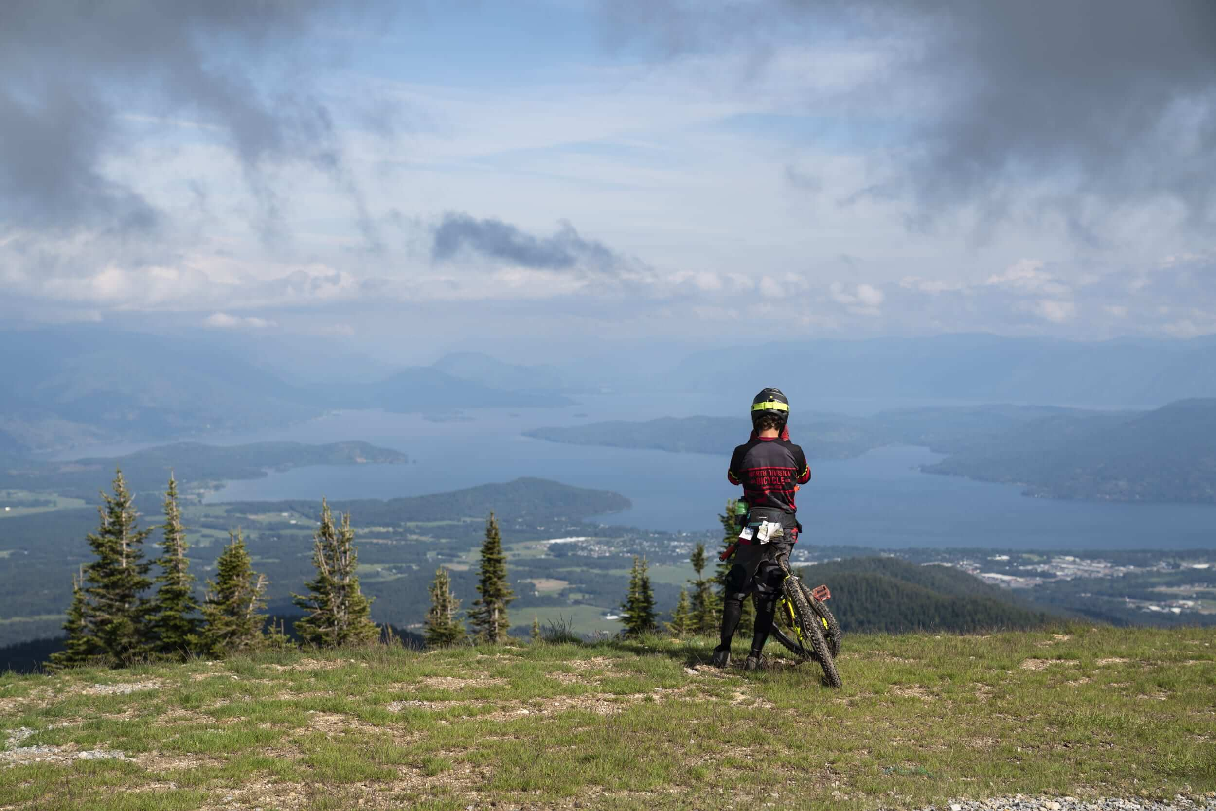 Taking in the view while mountain biking at Schweitzer Mountain Resort