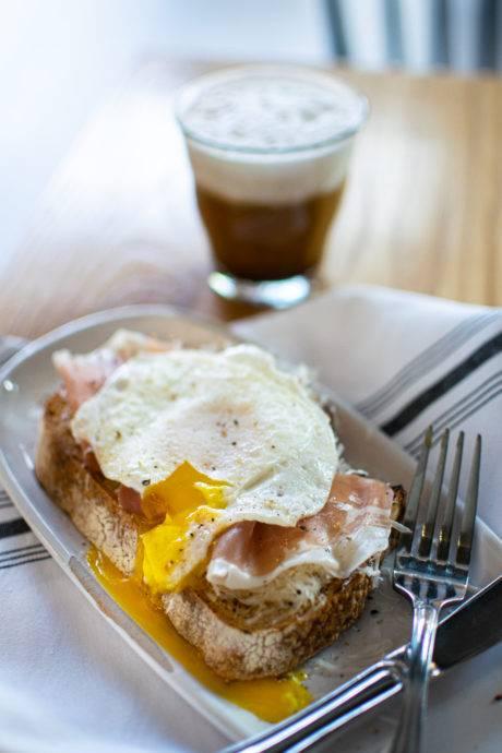 coffee and breakfast sandwich