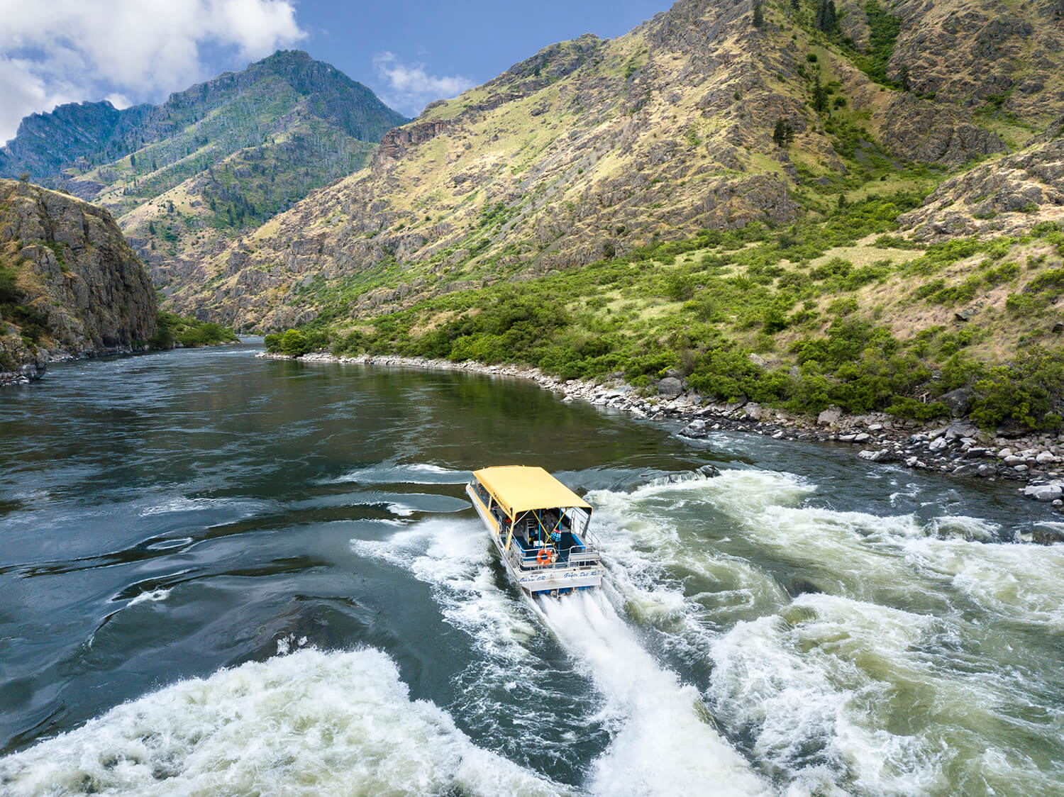 jet boat navigating the river in hells canyon