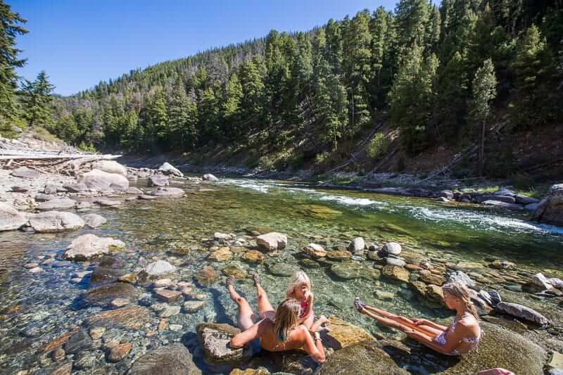 mom and daughters in hot spring
