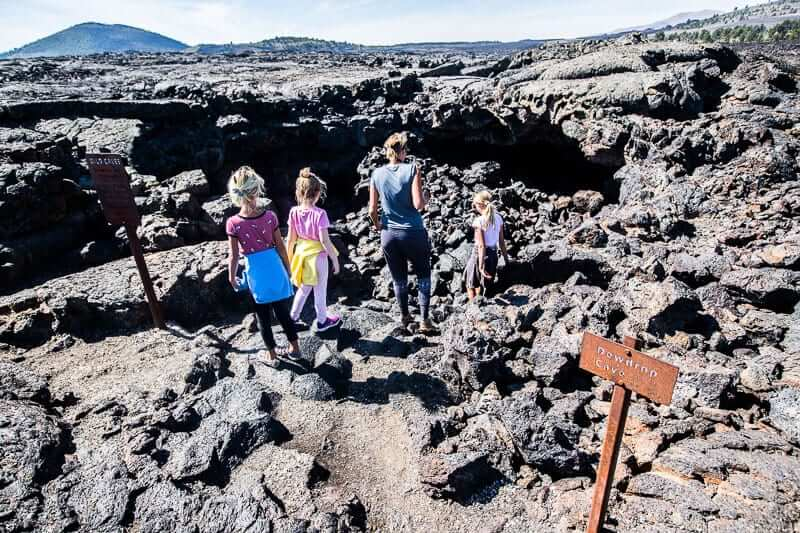 family walking down into a lava tunnel
