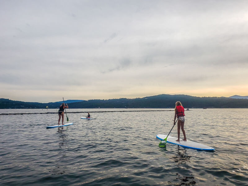 mom and daughter on paddle boards
