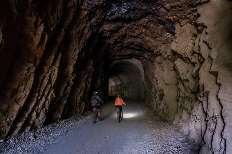 bike rider going through tunnel