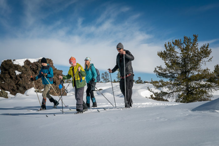 family cross country skiing at craters of the moon