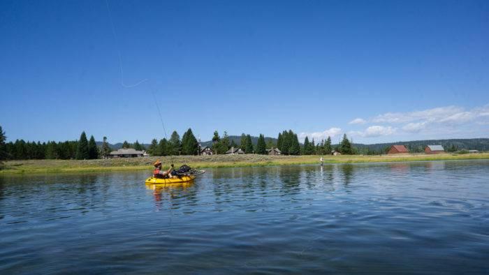 man in raft, fishing on river
