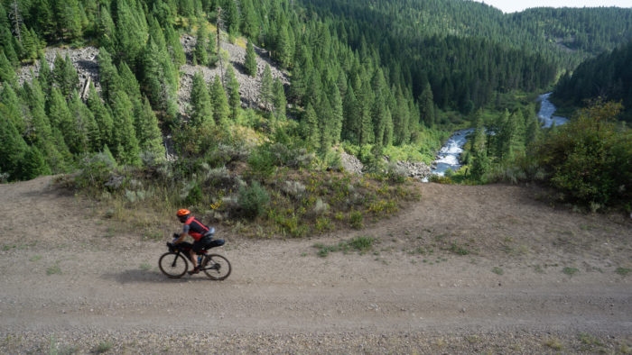 cyclist on a path, with river below