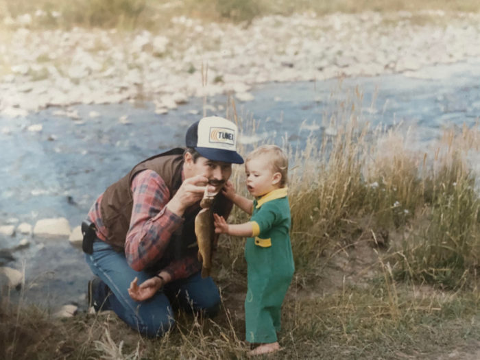 A father and daughter show off a fish they caught in Idaho.