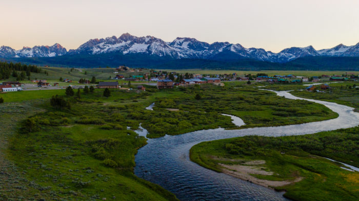 stanley valley surrounded by sawtooth mountains
