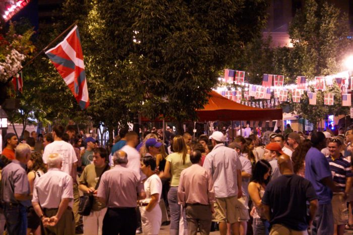 people walking the basque block during jaialdi