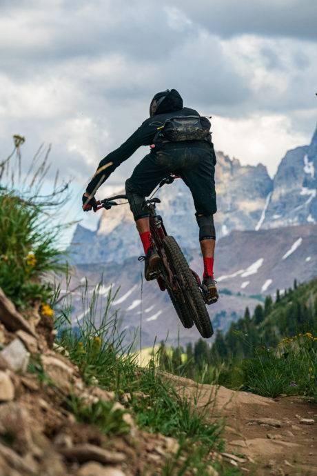 man mountain biking in teton valley
