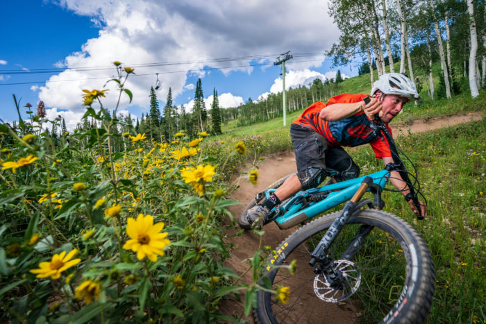 man cycling on mountain trail