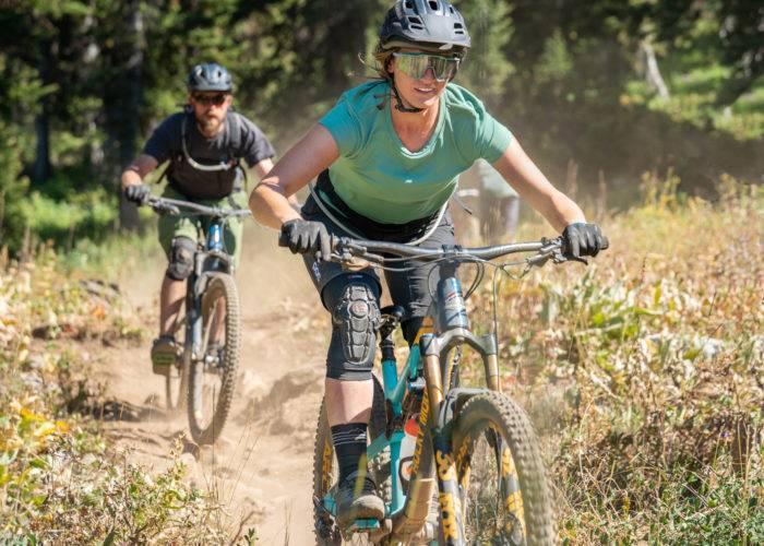 man and woman mountain bike riding teton valley
