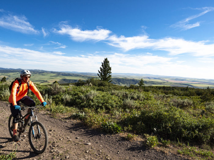 mountain biker on ridgeline at Kelly Canyon