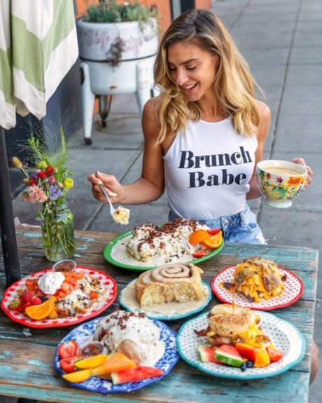woman eating breakfast foods