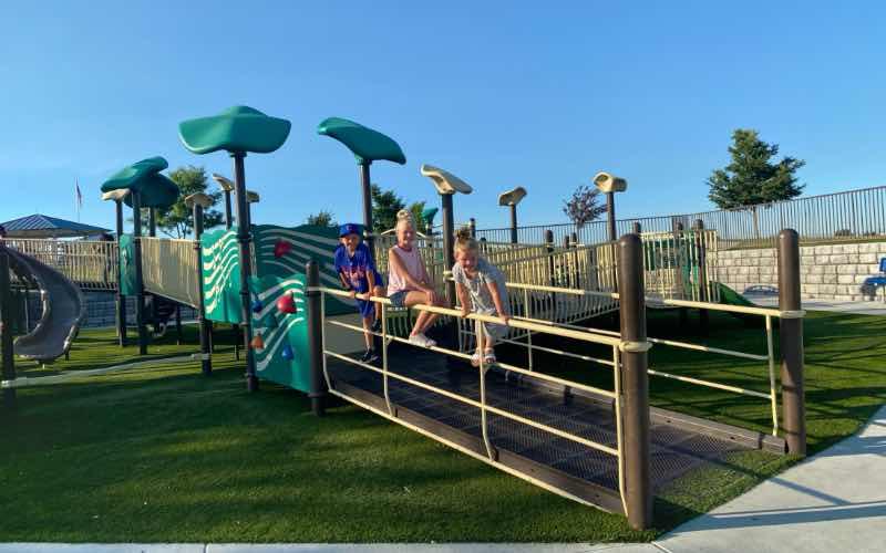 three children climbing on playground equipment at Mallard Park