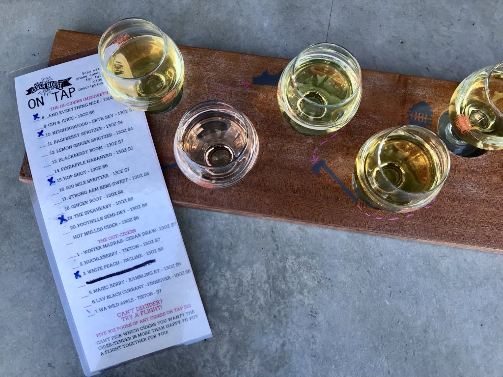 top view of a menu and a flight of five ciders