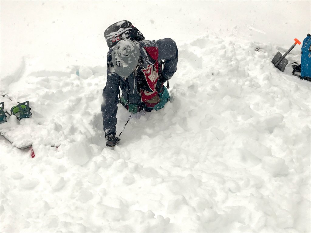 person in avalanche training in the snow