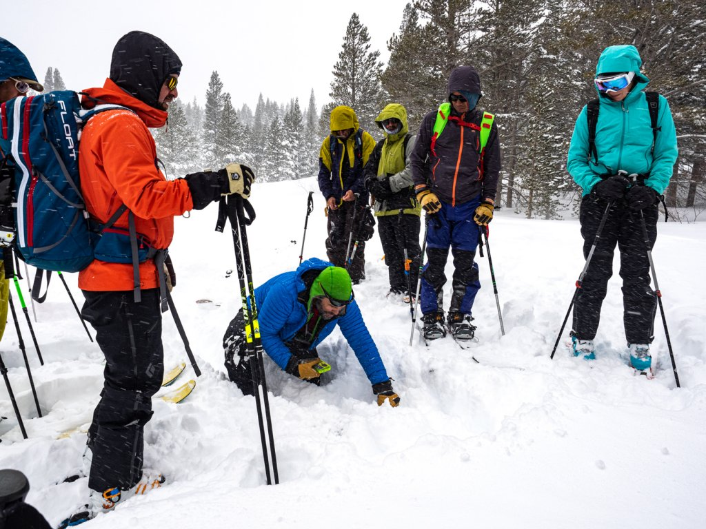 people in an avalanche safety course