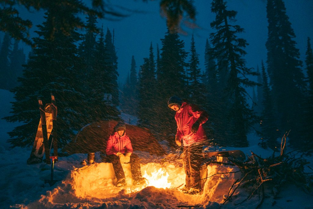 people around campfire in the snow