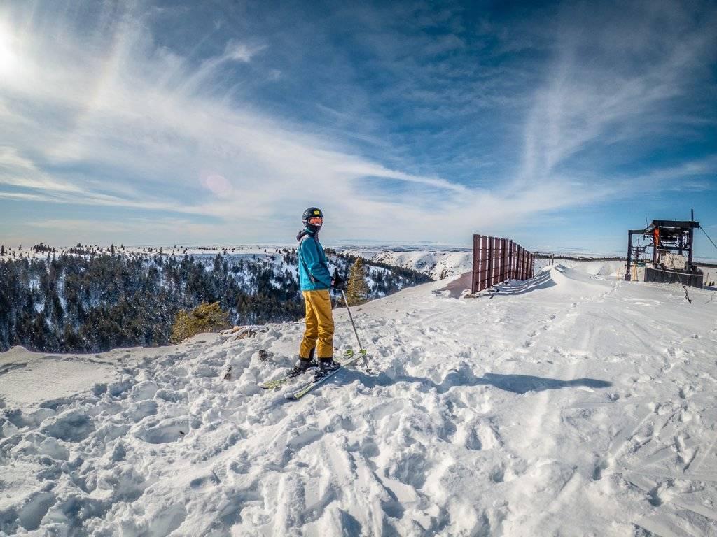 man on ski slope at Kelly Canyon
