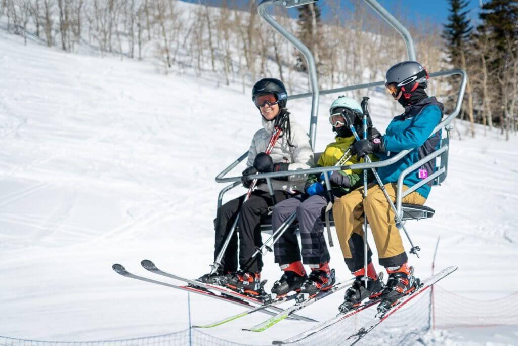 family on ski lift at Pomerelle