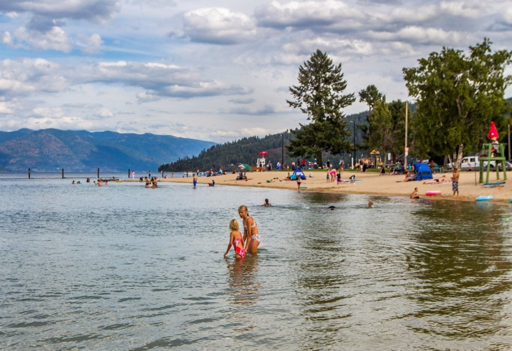 mom and daughter in lake at sandpoint