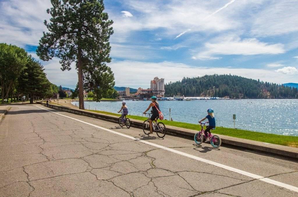 mom and two kids riding bikes along Lake Coeur d'Alene
