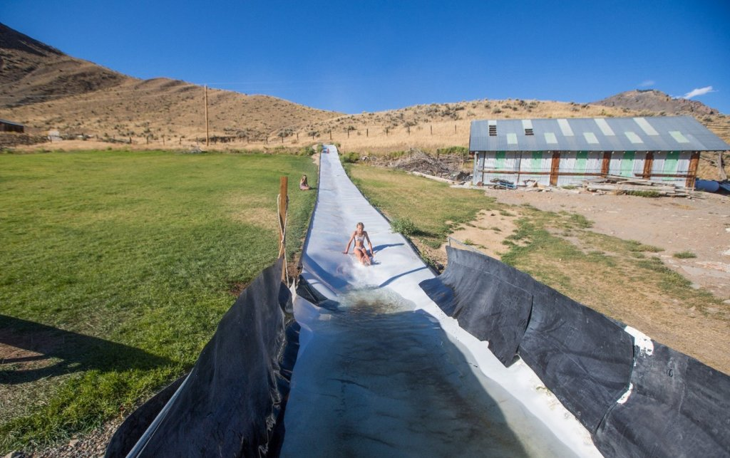 child on waterslide at ranch