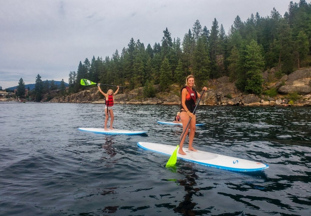 mom and daughter on standup paddleboads on lake coeur d'alene