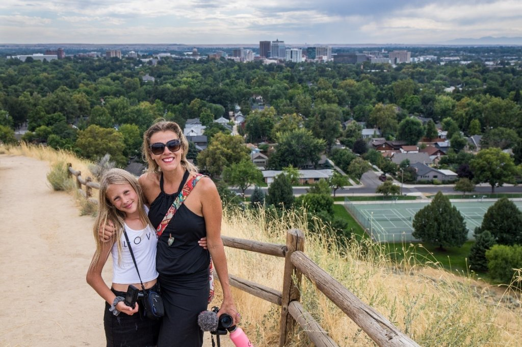 mom and daughter on hill overlooking Boise