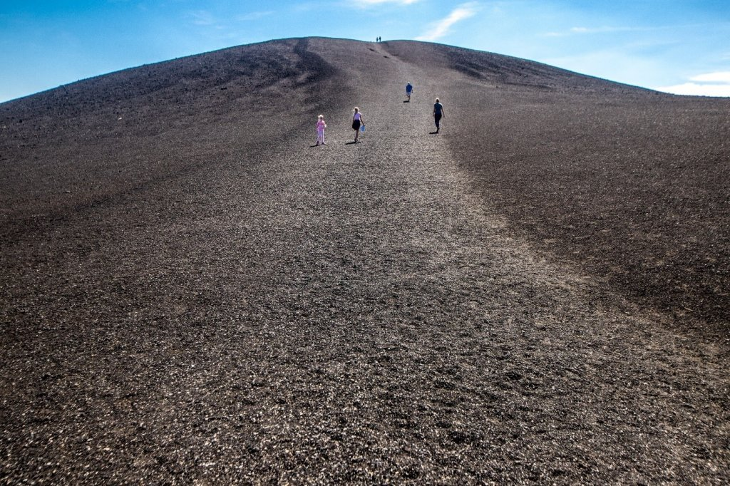 people running up hill at craters of the moon