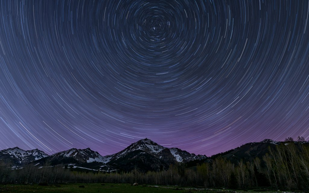 Star trails create a circular motion in the night sky at the Central Idaho Dark Sky Reserve